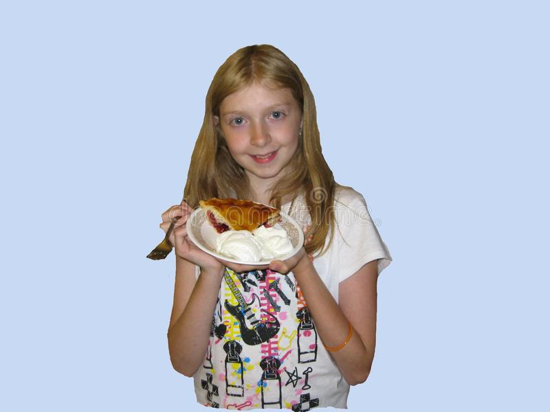 Girl holds her big piece of pie royalty free stock photography