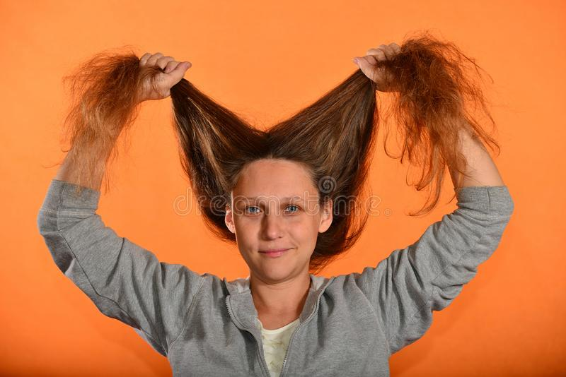 The girl holds her hair up and they bloom on the fly on a yellow background.  royalty free stock image