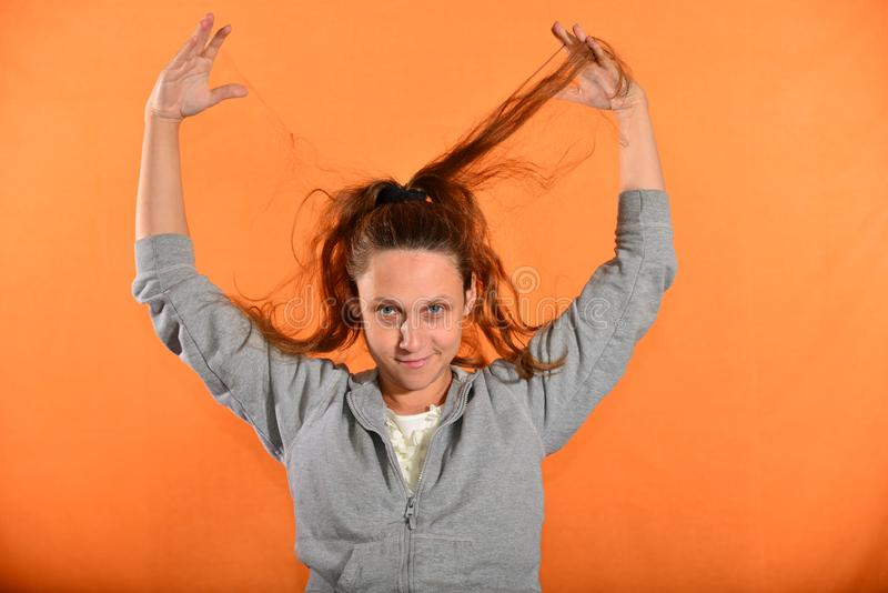 The girl holds her hair up and they bloom on the fly on a yellow background.  royalty free stock images