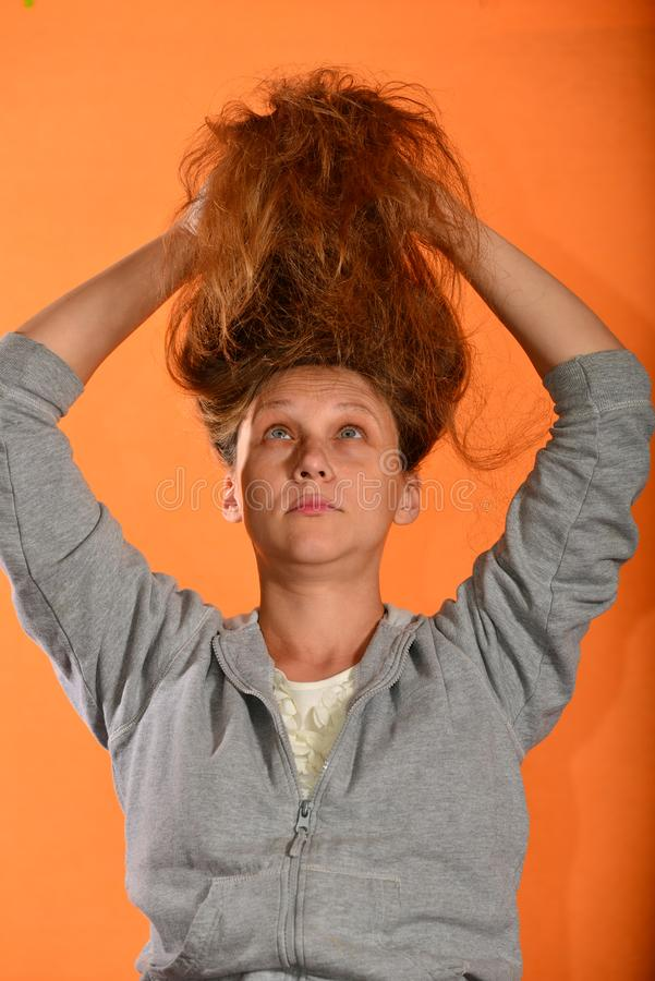 The girl holds her hair up and they bloom on the fly on a yellow background.  stock photos