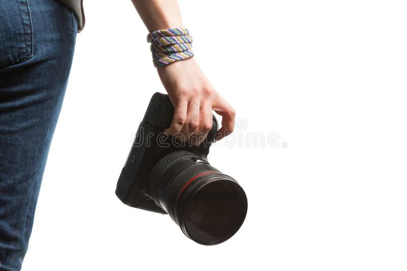 Girl holds in her hand a DSLR camera. Isolated on white background royalty free stock images