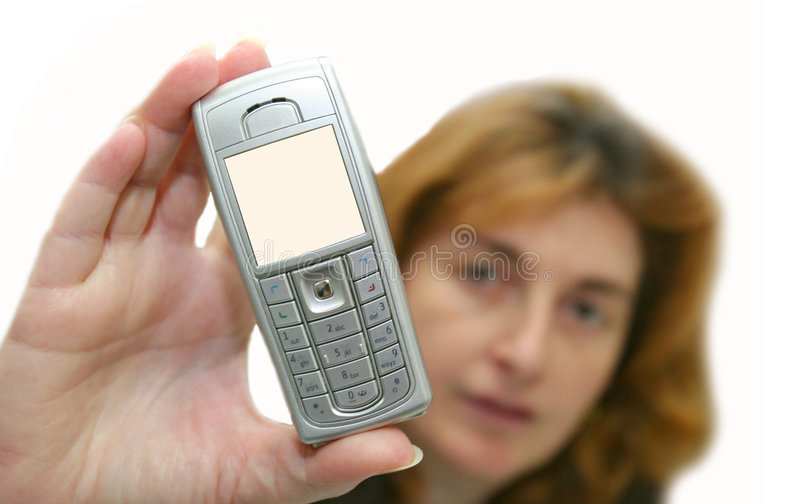 The girl holds a mobile phone royalty free stock image