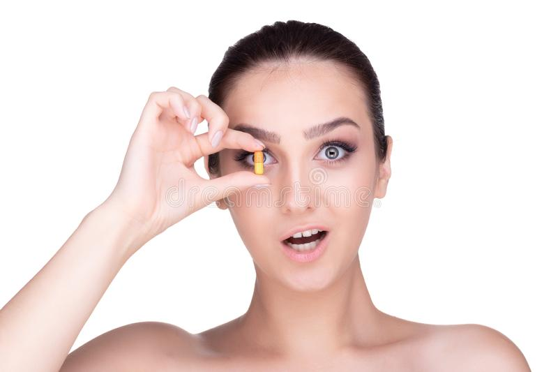 Girl holds a tablet close to the eye . isolate stock photos