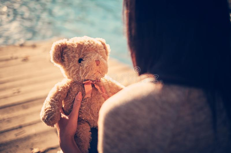 Teddy bear and pretty girl royalty free stock photography