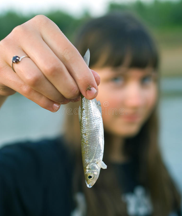 Free Girl Holds The First Caught Fish In A Hand Stock Images - 11206964