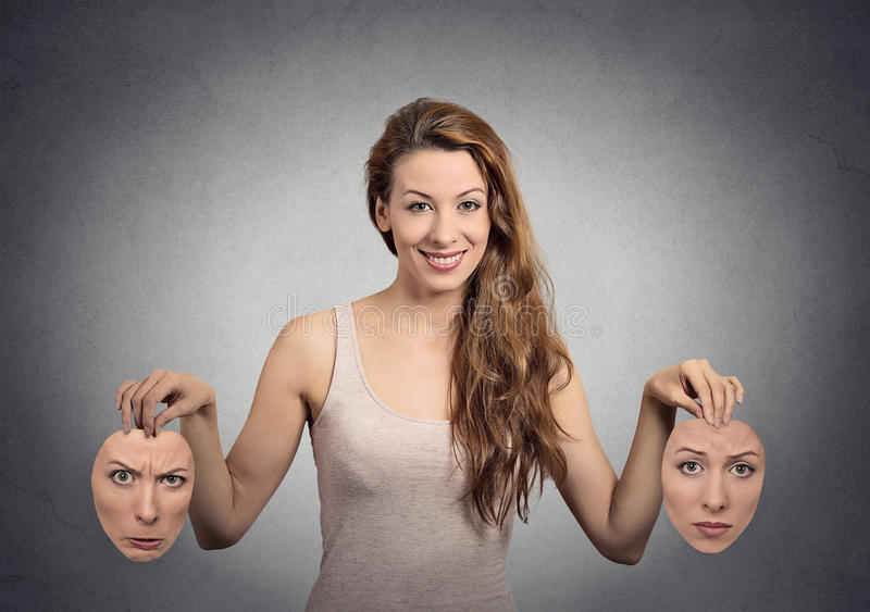 Girl holds two face masks stock photo