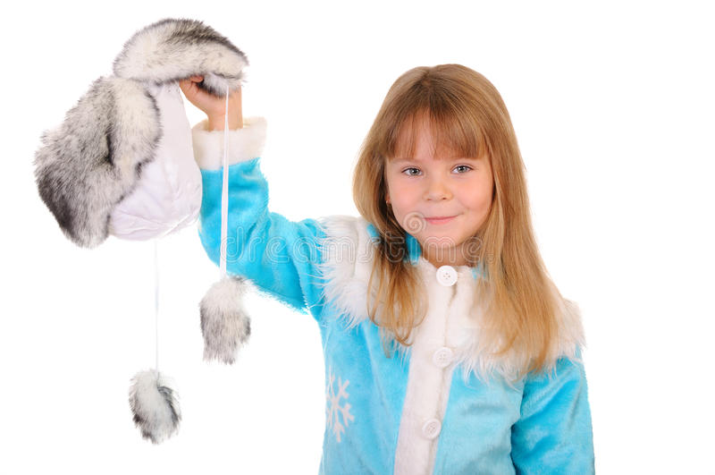 Girl holds winter fur cap. The girl holds in a hand a winter fur cap on a white background stock images