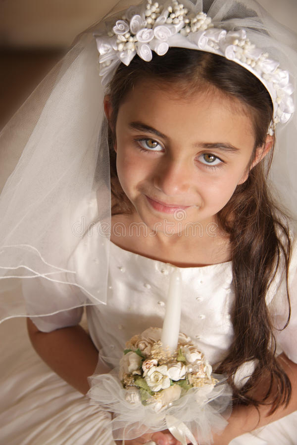 Girl in Holy Communion Dress with candle royalty free stock photo