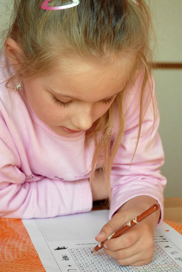 Girl With Homework Stock Photos