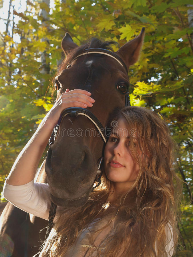 Girl and a horse stock photography