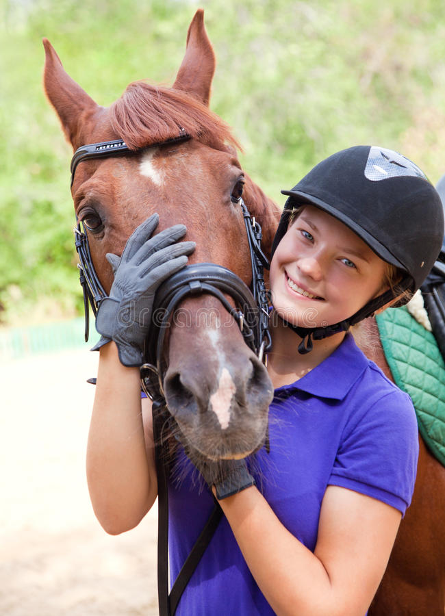 Girl with horse. Portrait of young horsewoman and brown horse stock images