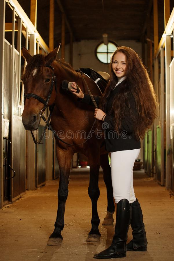 Girl with horse. Beautiful girl with her horse in a stall stock images