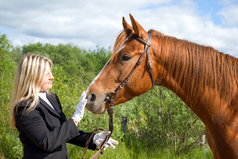 Girl with horse.Friendship. Of an animal and the person stock photo