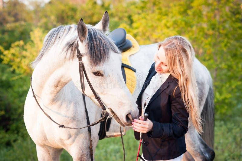 A girl and a horse royalty free stock photos