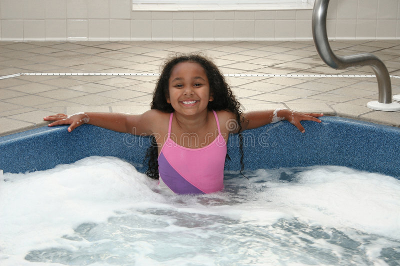 Girl in Hot Tub. Adorable African American 8 year old girl in hot tub stock images