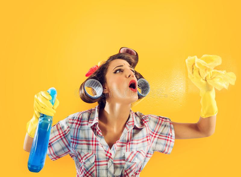 Girl housewife with gloves and spray ready to clean royalty free stock photos