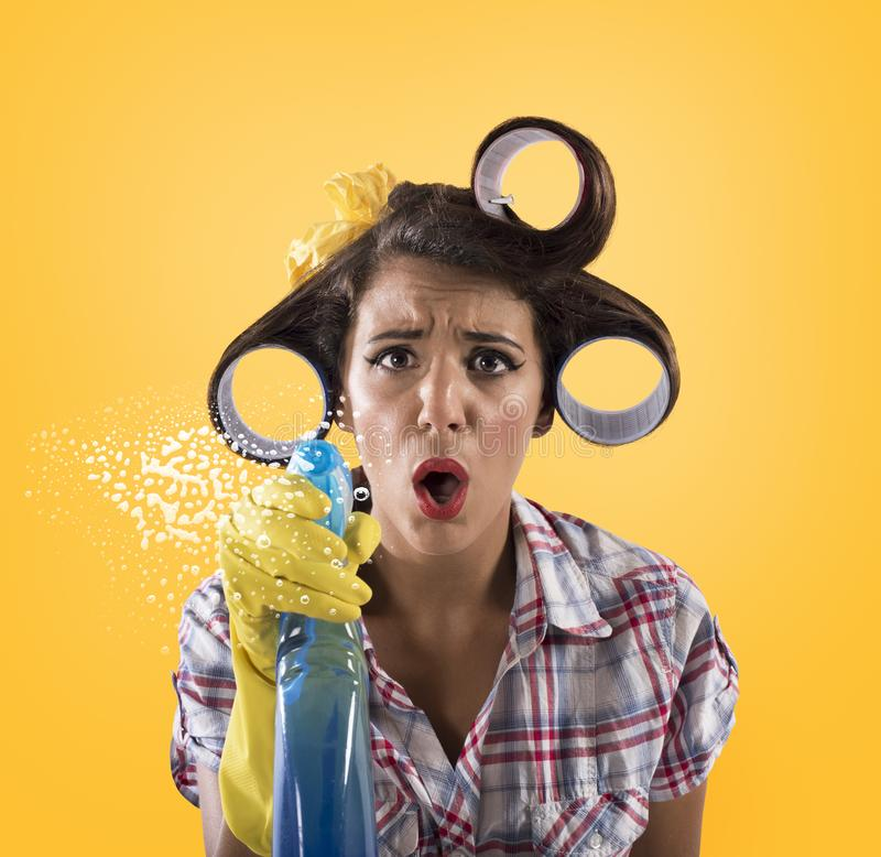 Girl housewife with gloves and spray ready to clean stock photos