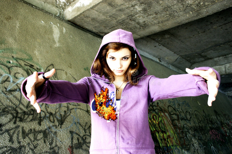 Girl hug. Pretty girl hug - graffiti wall background stock photo