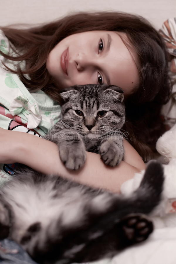 Download Girl hugging cute kitten stock image. Image of pretty - 26371417