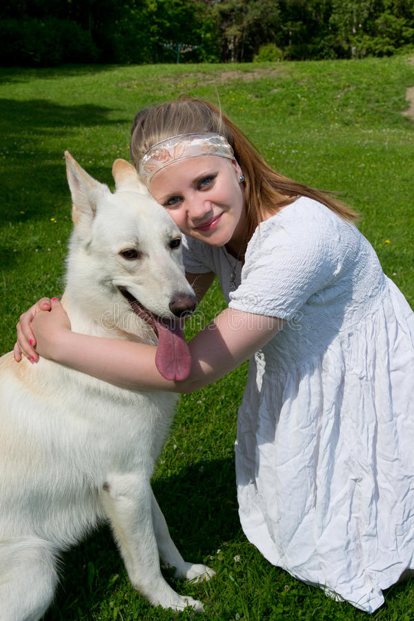 Download Girl hugging a dog stock photo. Image of heavy, green - 25797976