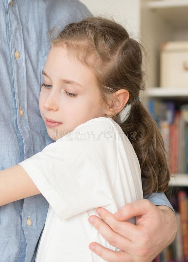 Girl hugging her dad. Cute little girl hugging her dad stock images