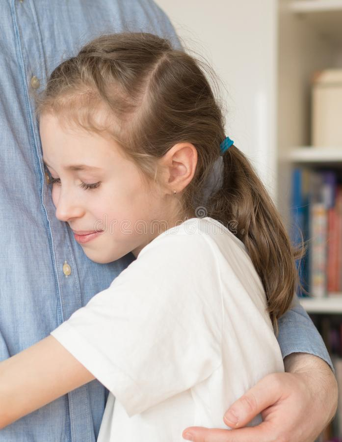 Girl hugging her dad. royalty free stock photography
