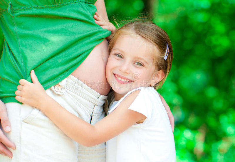 Download Girl Hugging Mother's Belly Royalty Free Stock Images - Image: 25975539
