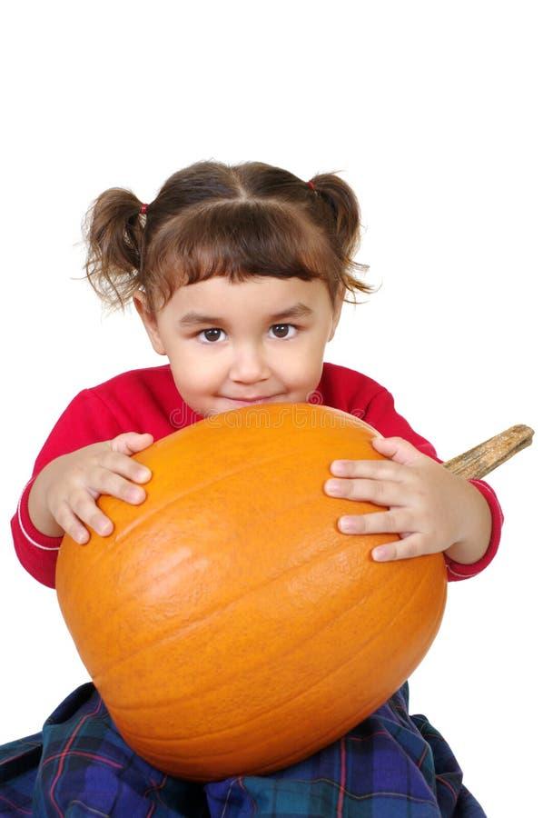 Girl hugging a pumpkin stock photos