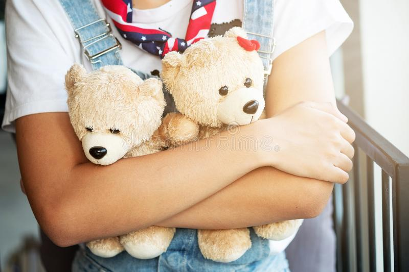 Girl hugging two teddy bears in a coffee shop. Valentine`s Day, love concept stock photos