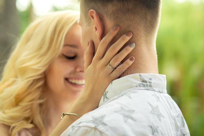 Girl hugs and kiss a guy. Nlove girl hugs and kiss a guy royalty free stock photo