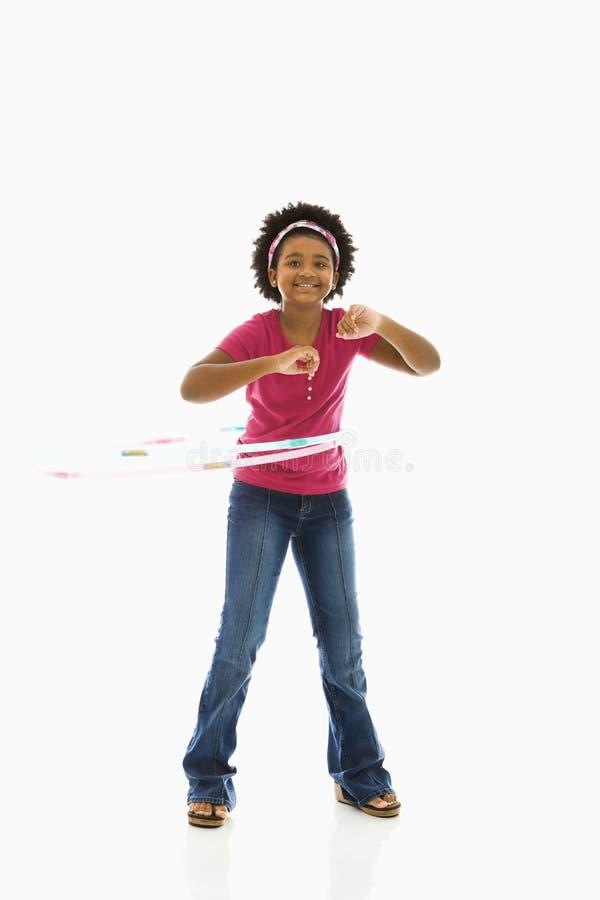 Girl with hula hoop. stock photography