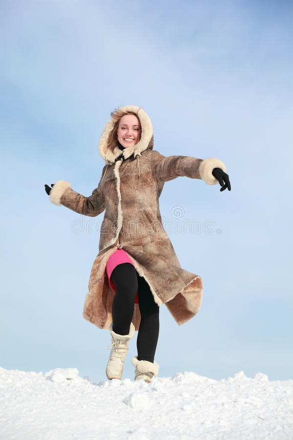 Download Girl Hurries Forward On Snow And Swings Arms Stock Photo - Image: 19719802