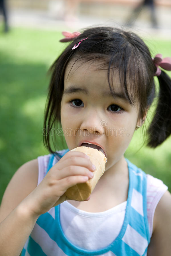 Download Girl with ice-cream stock photo. Image of kids, cute - 10618676