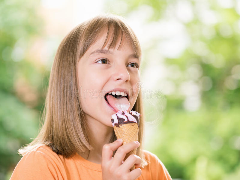Girl with ice cream. Outdoor portrait of happy girl 10-11 year old with ice cream cone royalty free stock image