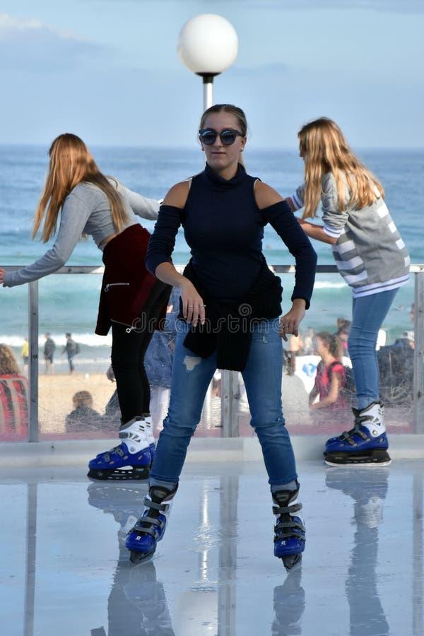 A girl ice skating on Bondi ice rink. Sydney, Australia - Jul 17, 2016. A girl ice skating on Bondi ice rink. Australia's only beachside ice rink is on Bondi stock images
