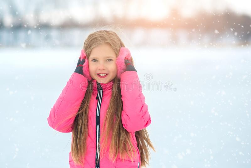 The girl on ice skating in pink wear. royalty free stock images