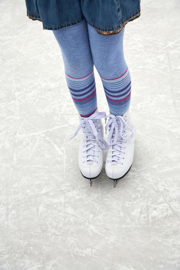 Girl ice skating on rink. Girl ice skating. child winter outdoors on ice rink. ice and legs royalty free stock images