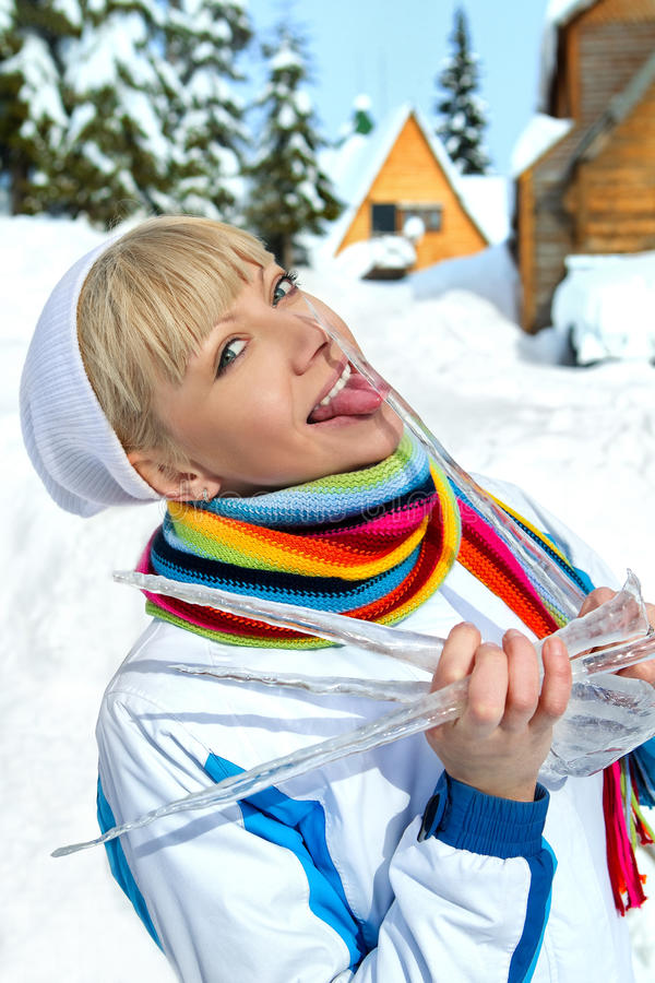 Girl with icicle royalty free stock photography