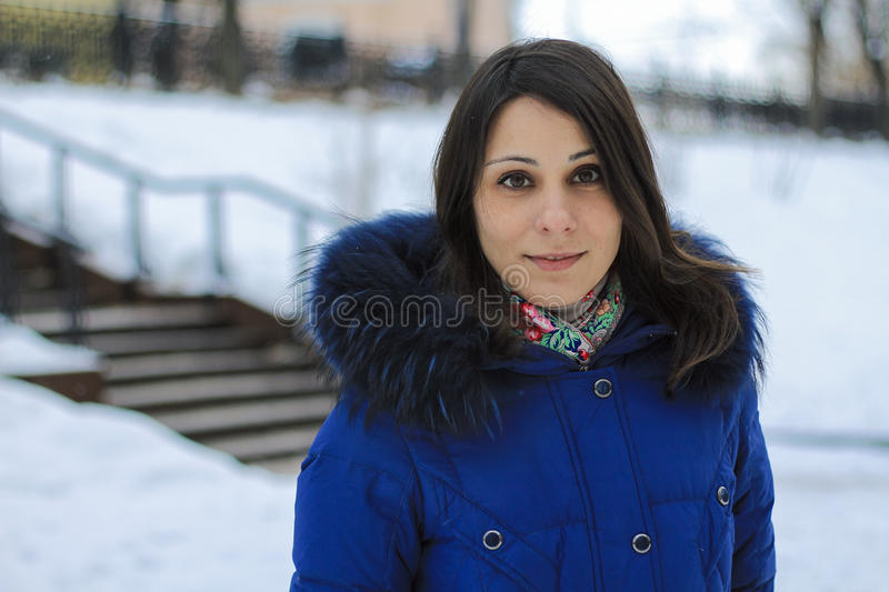 Girl and the icy stairs. Winter in Moscow royalty free stock images