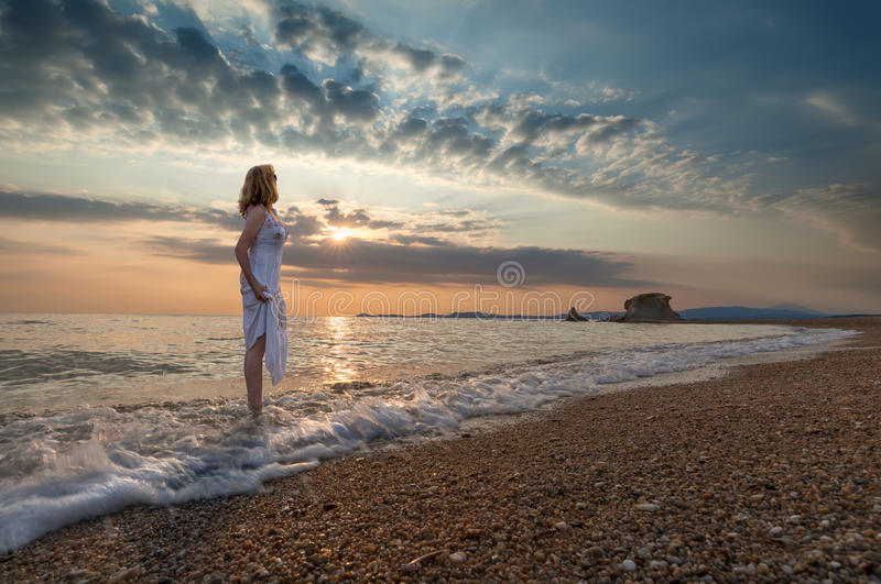 Download Girl On Idyllic Beach In Waves At Beautiful Sunrise Stock Photo - Image: 75302280
