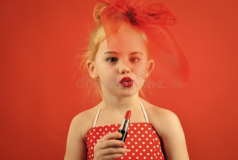 Girl imitates her mother. Retro girl fashion with cosmetics, beauty. retro girl with red lips. royalty free stock image
