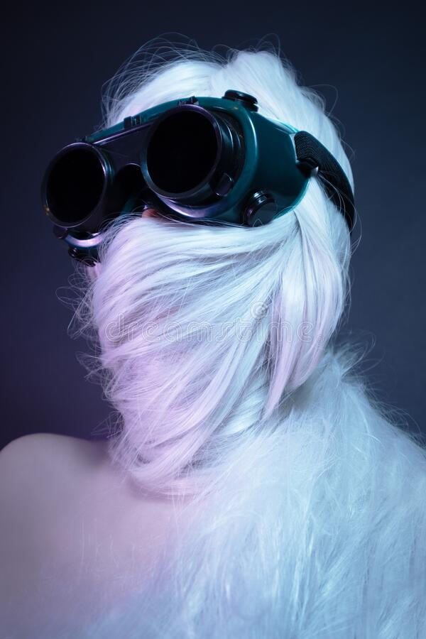 Free Girl In Black Glasses With Long White Hair Wrapped Around Her Head Royalty Free Stock Photography - 192163377
