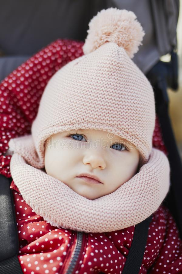 Free Girl In Bright Stylish Clothes Sitting In Pushchair Outdoors On A Fall Day Stock Photography - 152872062
