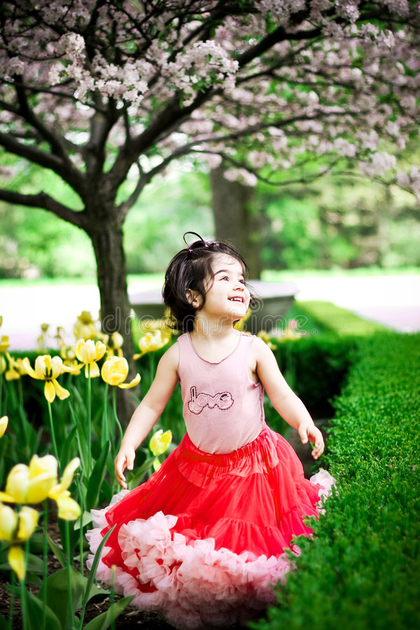 Free Girl In Flower Garden Royalty Free Stock Photography - 5193337