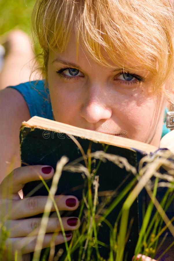 Free Girl In Grass With Book Stock Photo - 20610020