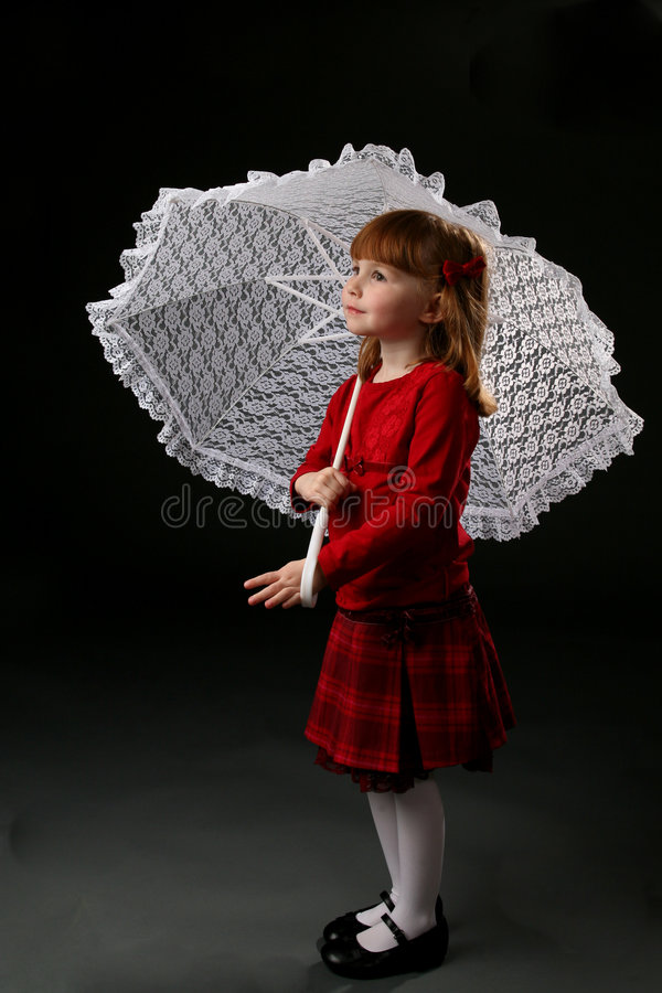 Free Girl In Red Holding A Parasol Stock Photos - 5704893