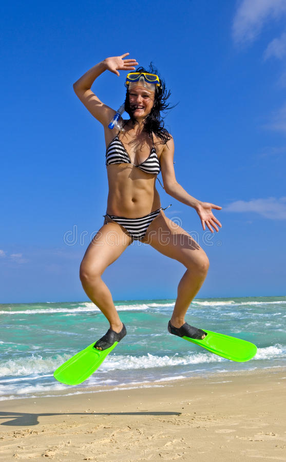 Free Girl In Swimming Mask And Fins Jumping At A Beach Stock Images - 16377444