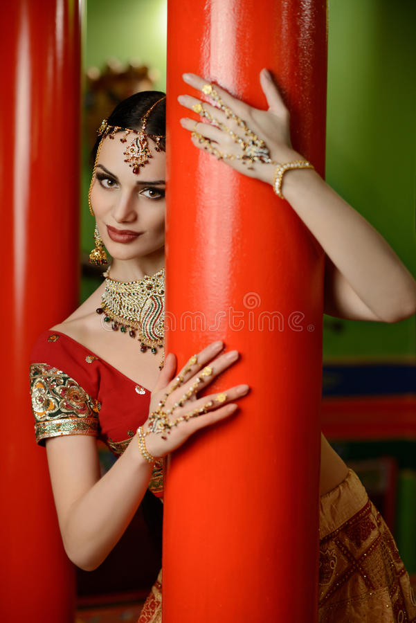 Girl in Indian national costume. Young beautiful girl in Indian national costume royalty free stock image