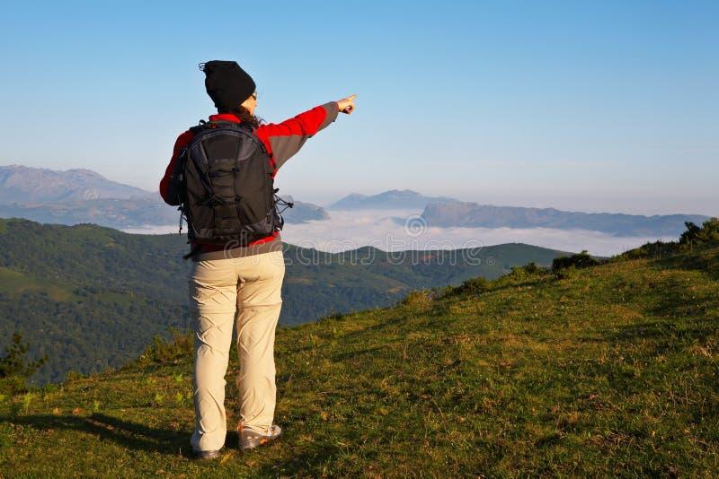 Girl indicating to the horizon stock image