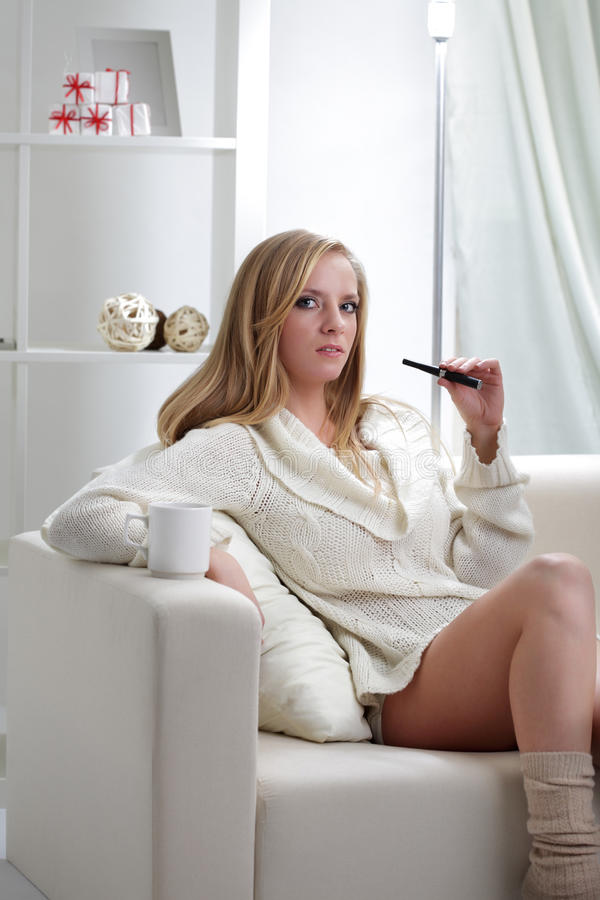 Girl Indoors With E-cigarette Stock Photo
